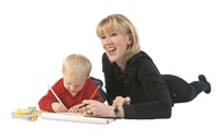 Photo of a child and his mom drawing and writing